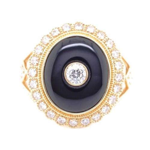 34 - Onyx, diamond and 18ct yellow gold dress ring with diamond set mille grain borders and split shoulde...