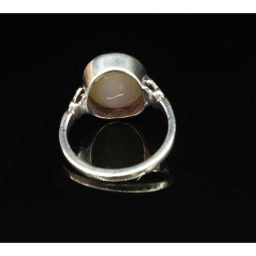 36 - Antique opal and white gold ring solid white opal with flashes of blue and greens, with hand made iv...