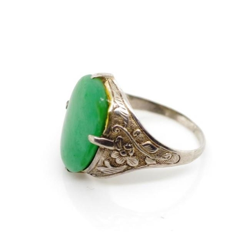 39 - Vintage Oriental jade and silver ring with floral repousse decorated shoulders, marked Oriental mark...