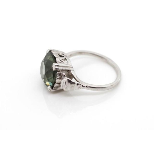 43a - Green gemstone and 9ct white gold cocktail ring marked 9ct, the gemstone tests as green tourmaline w...