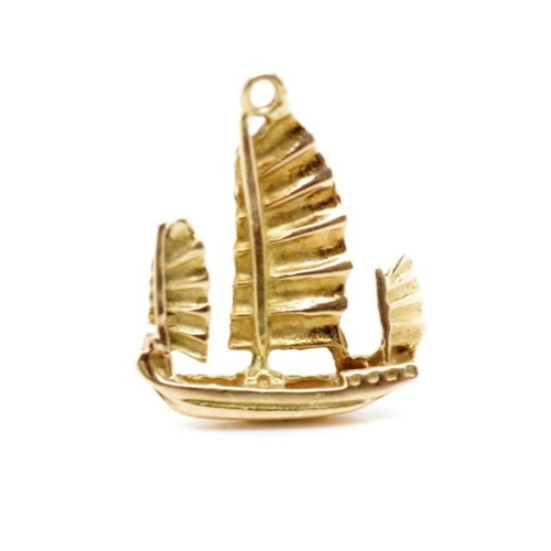 48 - 14ct Rose gold junk boat charm marked 14ct. Approx weight 1.3 grams...