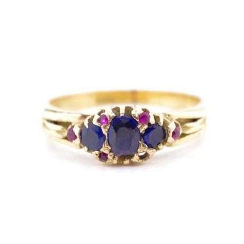 49 - Gemstone and 18ct yellow gold ring ,marked 18ct pall. A/F to center stone and one missing. Tests as ...