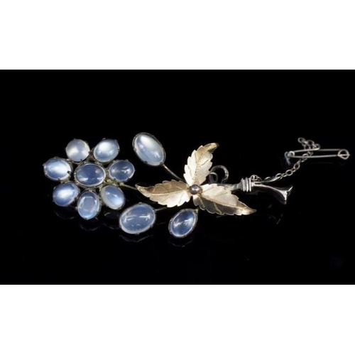 56 - Antique moonstone and silver flower brooch unmarked. Approx length 80mm,...