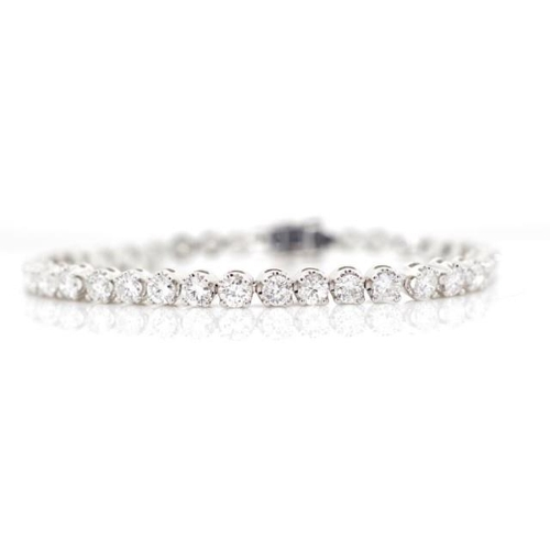 7 - 6.45ct diamond and 18ct white gold tennis bracelet marked 750, with box clasp and safety catch faste...