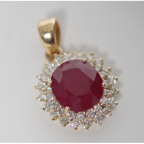 20 - Ruby, diamond and 18ct yellow gold cluster pendant , approx 1x oval cut natural ruby 13.77 x 12.45 x...
