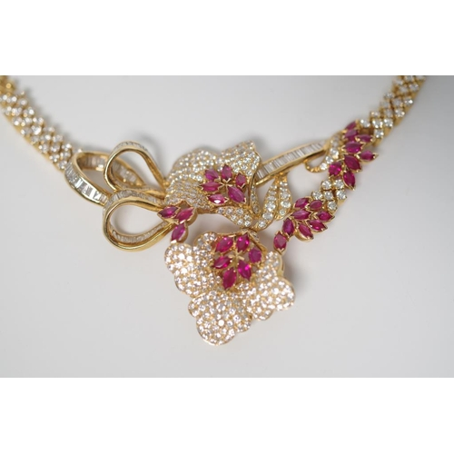 27 - Ruby and diamond set 18ct yellow gold necklace of flower form design with bead work links and box cl...