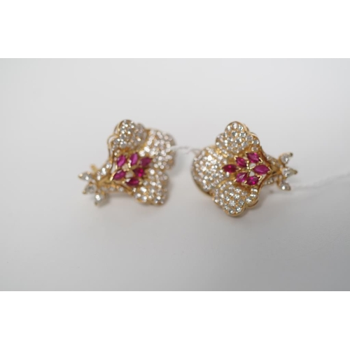 55 - Ruby, diamond and 18ct yellow gold earrings of Orchid flower form. Approx 12x marquise natural rubie...