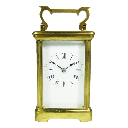 130 - A gilt brass carriage clock, the movement striking on a gong, height 12.5cm (5in.)....