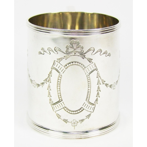 1 - A silver christening mug, of slightly flared cylindrical form, with reeded borders, chased with a va...