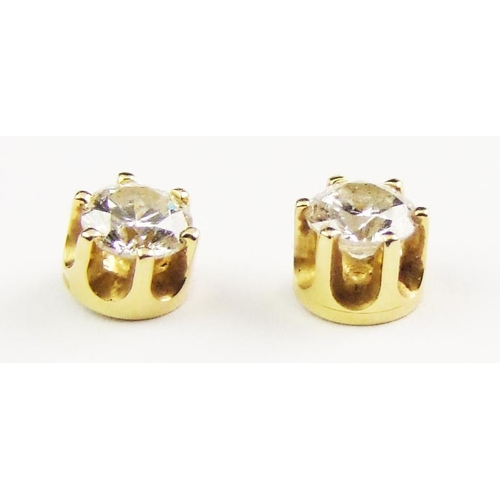 10 - A pair of diamond-set stud earrings, each set with a brilliant-cut diamond weighing approx. 0.45 car...