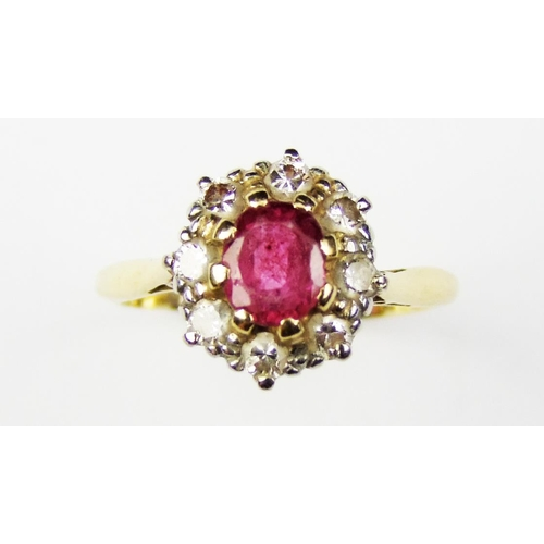 14 - A pink sapphire and diamond-set cluster ring, the oval mixed-cut sapphire within a surround of circu...