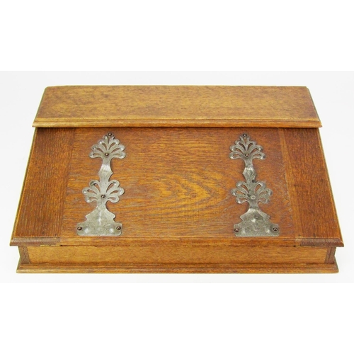 19 - An oak writing slope, fitted with a single inkwell, width 32cm (12 1/2in.)....