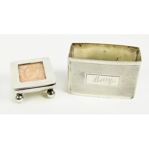 25 - An Edward VII silver stamp box, the hinged cover inset with a one penny stamp, maker's mark of Levi ...