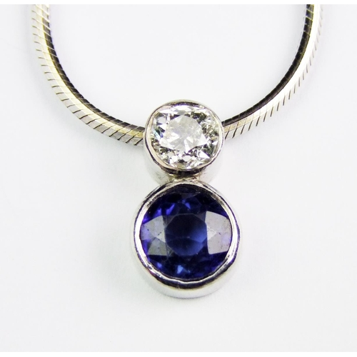 26 - A sapphire and diamond pendant necklace, the pendant comprised of an old brilliant-cut diamond, weig...