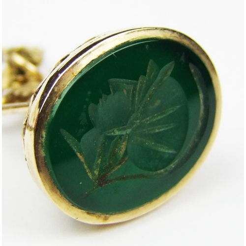 3 - A 9 carat gold seal in the form of the figure of Britannia, set with a green hardstone, suspended fr...
