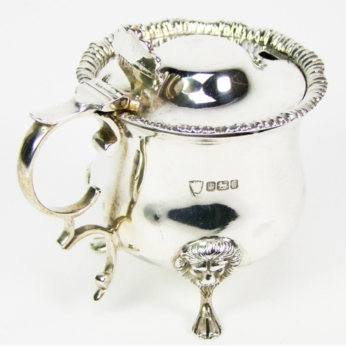 34 - An Edward VII silver mustard, of bulbous form, the domed hinged cover with shell thumbpiece, gadroon...