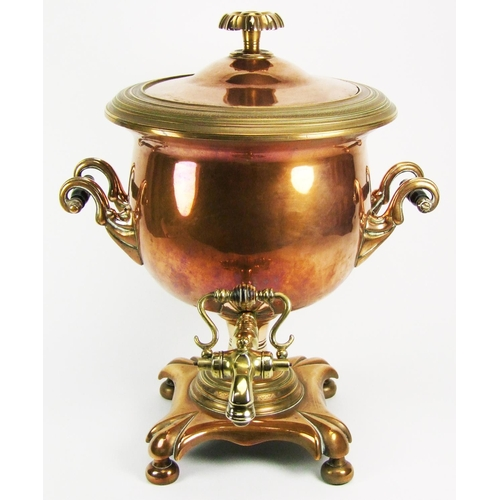 38 - A copper samovar, with twin handles and brass spigot, height 41 cm (16 1/8 in.)...