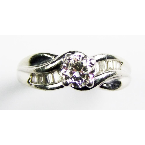 39 - A diamond single stone ring, the brilliant-cut diamond, weighing approx. 0.60 carats, above the scro...