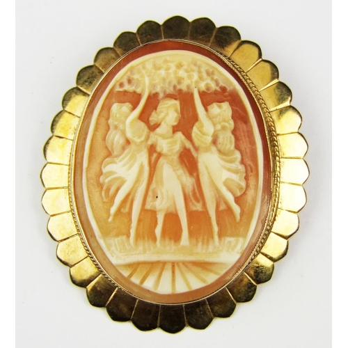 4 - An oval shell cameo brooch, depicting the three graces, in a 9 carat gold mount...
