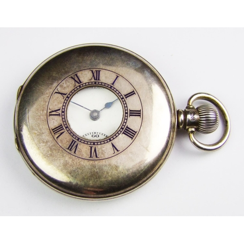 40 - A silver Omega half hunter pocket watch, the white ceramic dial signed Omega, seconds subsidiary dia...