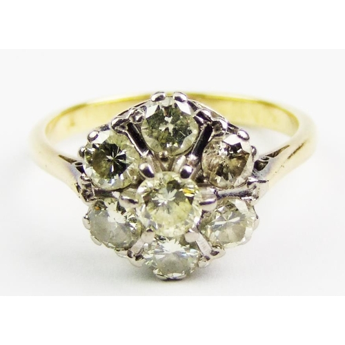 48 - A diamond cluster ring, the central brilliant-cut diamond surrounded by six slightly smaller diamond...