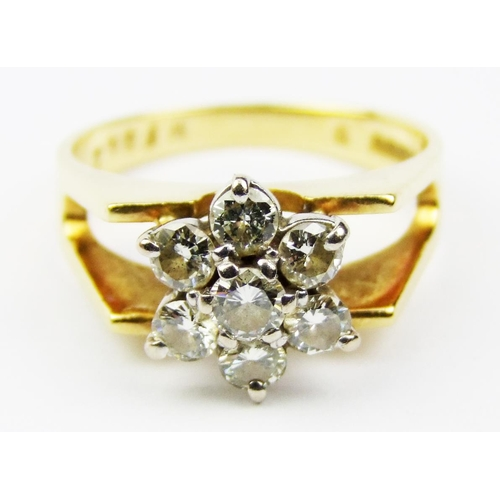 5 - A diamond set cluster ring, the central flowerhead comprised of seven brilliant-cut diamonds, to the...
