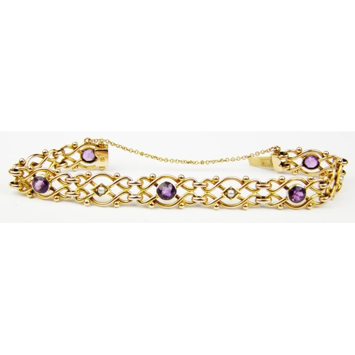 8 - An Edwardian amethyst and pearl bracelet, comprised of openwork scroll sections set alternately with...