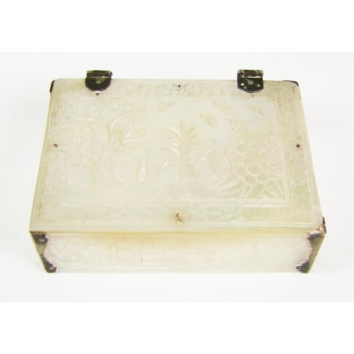 123 - A mother-o'-pearl and white metal mounted trinket box, engraved with birds and butterflies, width 7....