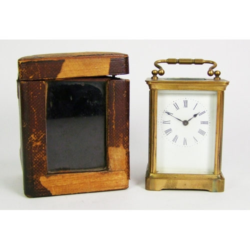 133 - A brass carriage timepiece, height 10.5cm (4 1/2in.)....