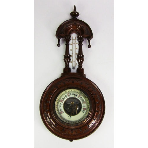 135 - An aneroid barometer, in stained wood case, height 40.5cm (16in.)....