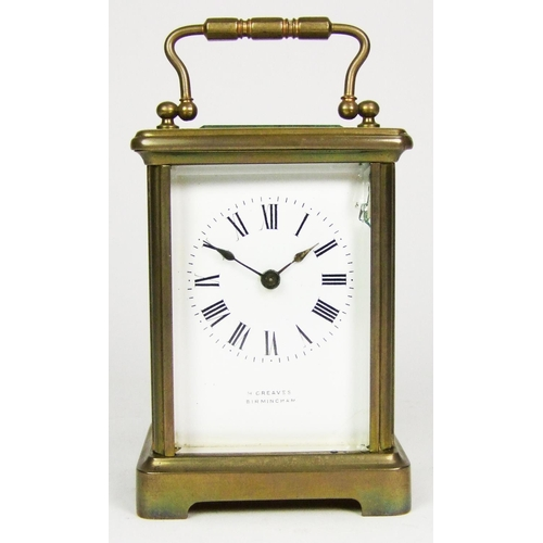 140 - A brass carriage timepiece, the white enamel dial signed, Greaves, Birmingham, height 12cm (4 3/4in....