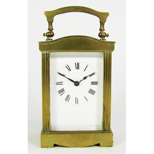 141 - A brass carriage timepiece, height 12.5cm (5in.)....