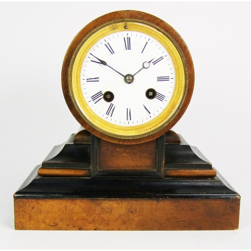 144 - A French walnut and ebonised mantel clock, the movement striking on a bell, the barrel movement on a...