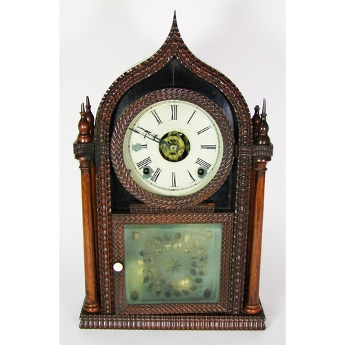 147 - An American rosewood clock, by J.C. Brown, Bristol,the arched case with ripple moulding, and flanked...