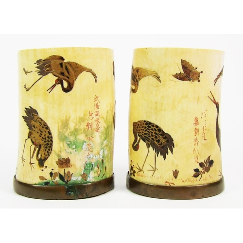 164 - A pair of Japanese carved ivory vases, painted with birds and butterflies, Meiji period, height 10cm...