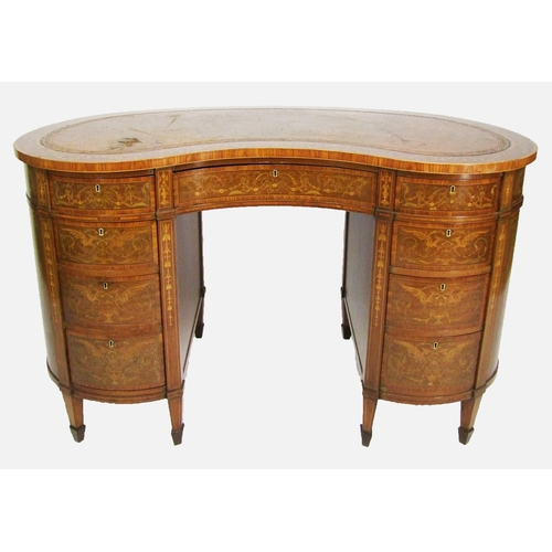 587 - An Edwardian mahogany, kingwood and marquetry kidney shaped desk, fitted with a central drawer, flan...