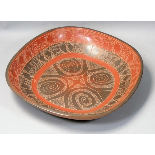 Siddig El Nigoumi (1931 - 1996), an earthenware burnished clay square dish, mottled brown and terra-cotta colours, incised scroll motifs, signed and dated 1986, 28 cm.