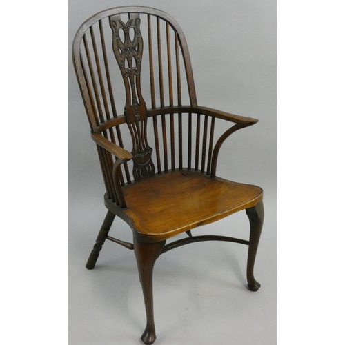 405 - A mahogany gentleman's Windsor type armchair, with floral splat, cabriole front legs, 57 cm wide.