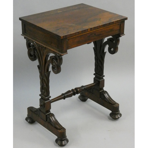 412 - A 19th century rosewood side table, with frieze drawer, lacking slide beneath, to carved and and sha...