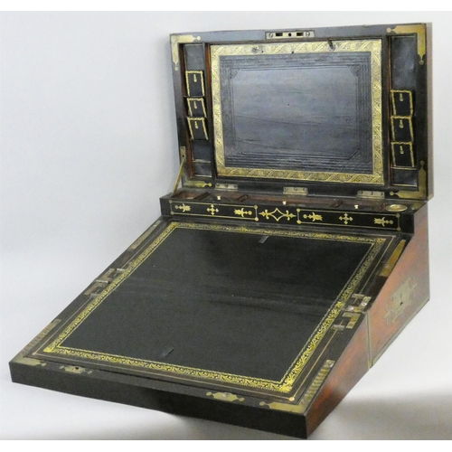 81 - A Georgian Military rosewood and brass inlaid  writing box, c.1830, the hinged lid with Thompson pat...