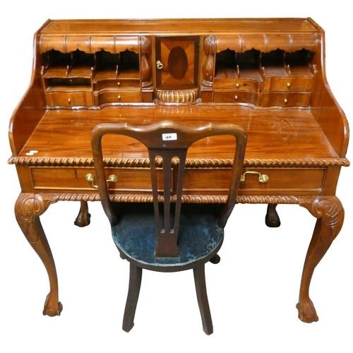 A Queen Anne style mahogany writing desk with fitted interior and claw and ball feet, 110cm long x 67cm deep x 105cm tall