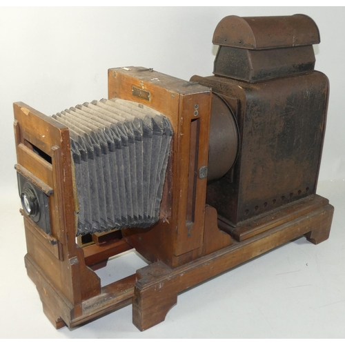 35 - A mahogany plate slide projector by Westminster Photographic Exchange Ltd., applied brass makers pla...