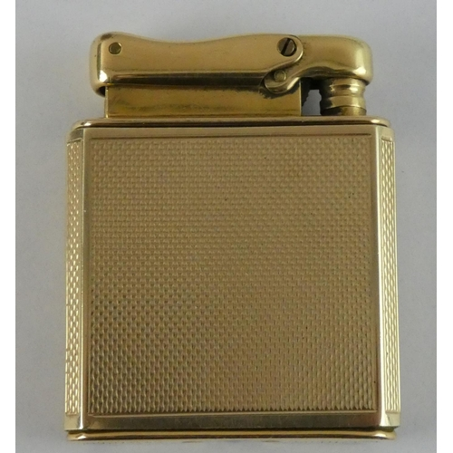 94 - A 9ct gold cased Calibre Mono Pol watch/lighter, c.1950, with engine turned gold sleeve, 17 jewel In...
