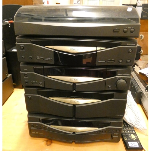 22 - A Kenwood stacking music system with multi CD, amp, AV control center, cassette deck and turntable, ...