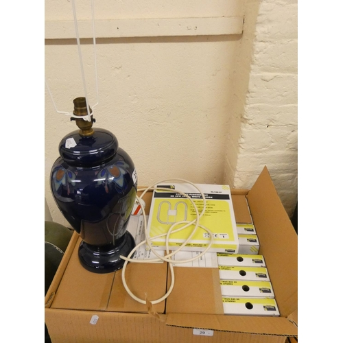 29 - A blue pottery table lamp and 20 compact flourescent 2 D 28W 2 pin bulbs...
