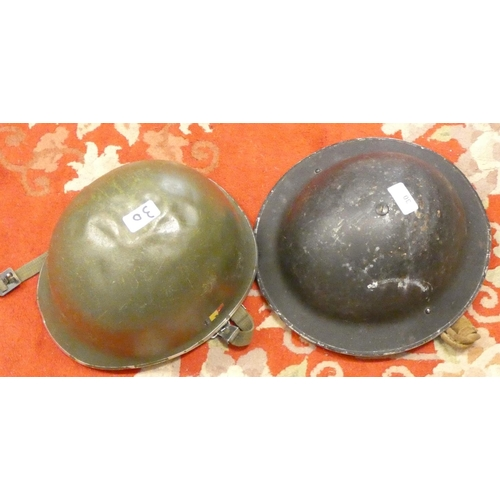30 - A British Army WWII type helmet and a German army helmet...