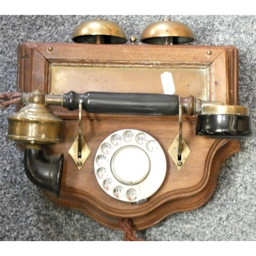 41A - An Edwardian style wall mounted telephone with brass bells...