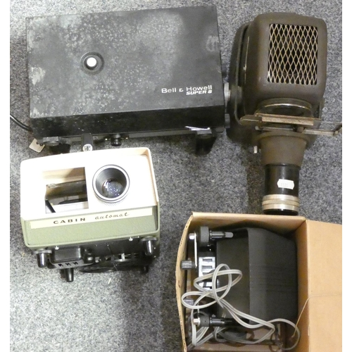 53 - A Bell and Howell slide projector, an Aldis slide projector and two other projectors...