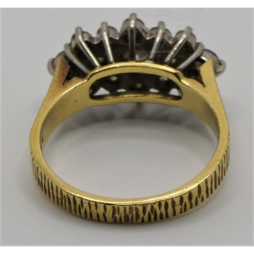 106 - An 18ct gold and diamond cluster ring, panel set with brilliant cut stones, total weight approximate...