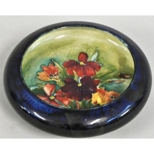 347 - A Moorcroft Iris pattern pin dish, typically tube lined with flowerheads and leafy stems in shades o...